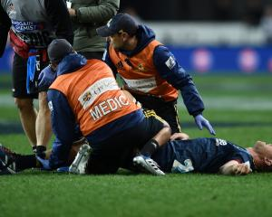 Josh Dickson of the Highlanders was taken off injured during the match against the Crusaders at...