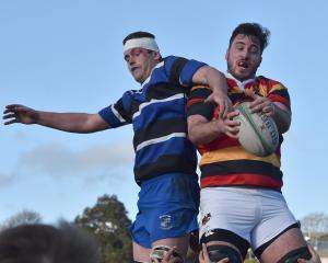 Kaikorai lock Zach McKenzie contests the ball which Zingari-Richmond's Keegan Anderson has...
