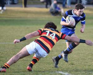 Kaikorai winger Jordan McEntee attempts to get past Zingari-Richmond opposite Willie Time at...