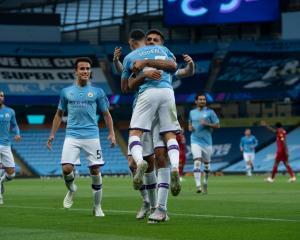 Phil Foden of Manchester City celebrates with his team mates after scoring this morning. Photo:...
