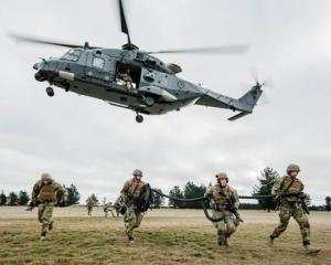 Fast-roping from a military helicopter is a quick method of troop insertion. Photo: Sean Spivey,...