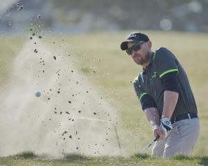 Island Park's Michael Smith escapes the greenside bunker on the third hole at Chisholm Links on...