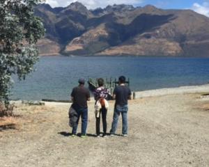 Tyler Nii's family look out over Lake Wakatipu earlier this week. Photo supplied