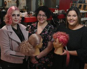 Hairdressing apprentices Rebekah Morton (left) and Tash Williamson (right) display their award...