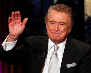 Television host Regis Philbin waves goodbye during his final show of on ABC's 'Live With Regis...