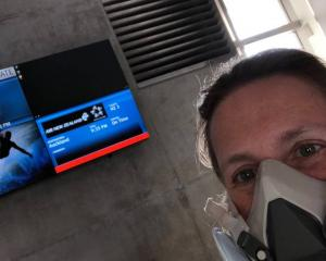 Dr Judy Melinek about to leave LAX airport complete with face mask, en route to New Zealand....