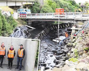 Work to fill a cavity in the Oamaru Creek bed is progressing well. Inset: District Council...