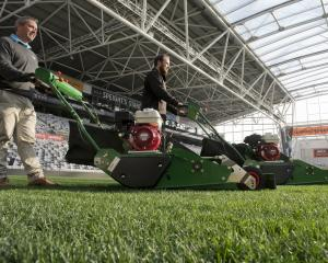 With the new mowers at Forsyth Barr Stadium are Power Turf South Island sales manager Jeremy...