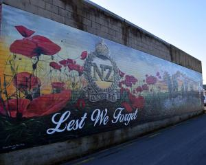 An Anzac-themed mural on a wall in Church St, Mosgiel. PHOTO: SHAWN MCAVINUE