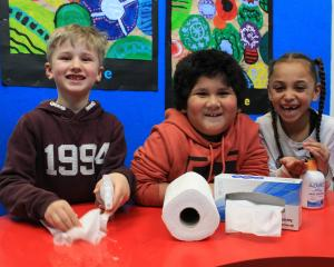 Tainui School pupils (from left) Jonas Machek (7), Harry Gill (7) and Annika Rudd (6) continue to...
