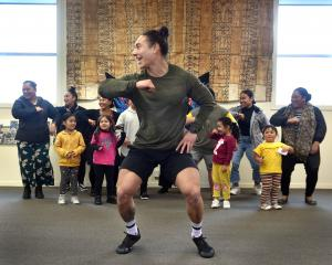 Dunedin researcher Troy Tararo-Ruhe joins members of the Dunedin Pasifika community in dance...