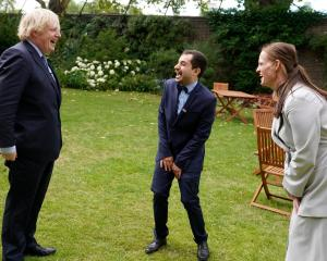Boris Johnson shares a joke with nurses Luis Pitarma and Jenny McKe. Photo: Boris Johnson/ Twitter