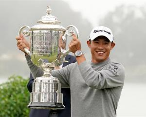 Collin Morikawa celebrates with the Wanamaker Trophy after winning the 2020 PGA Championship at...