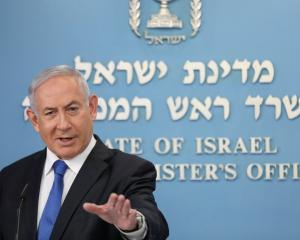 Israeli Prime Minister Benjamin Netanyahu announces a peace agreement to establish diplomatic...