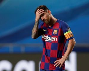 Barcelona captain Lionel Messi reacts to his side's worst ever loss in European football. Photo:...