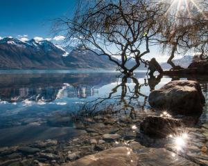 Lake Wakatipu is like a mirror as we cycle towards the Greenstone Valley. PHOTO: LAURENCE BELCHER...