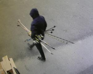 One of the people captured on CCTV helping himself to skis and poles from outside Hospice Shop...