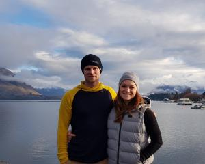 Jono and Sarah Reed model hoodies and beanies made from merino wool. PHOTO: SUPPLIED BY SARAH REED