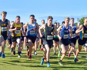 Runners take off from the start line of the Otago Cross Country Championships at Chisholm Golf...