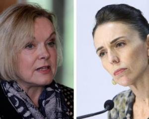National Party leader Judith Collins (left) says it should be health officials, not Labour leader...