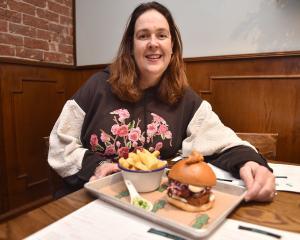 Dine Dunedin director Nicola McConnell prepares to tuck into a karaage chicken burger at Salt Bar...