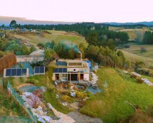 A drone image of Rhys Taylor and partner Anne Griffiths' property shows the home's solar panels...