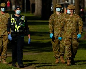 Police and Australian Defence Force members patrol the streets of Melbourne. Photo: Getty