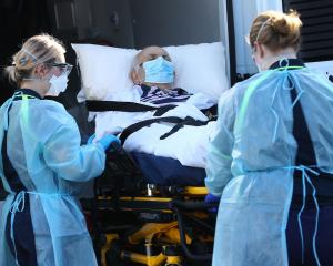A resident from an aged care facility is taken to hospital in Melbourne. Photo: Getty
