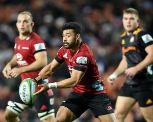 Richie Mo'unga of the Crusaders gets a pass away against the Chiefs. Photo: Getty Images