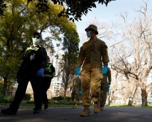 Members of the Australian Defence Force patrol Melbourne streets on Monday. Photo: Getty Images