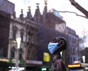 A statue wearing a face mask in central Melbourne. Photo: Getty Images