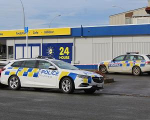 Police cars were parked up at the corner of Hensley and Dee Sts on Friday morning.