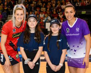 Burwood sisters Milla and Eden Peti got to meet their heroes, Tactix captain Jane Watson (left)...