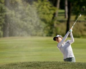 Lydia Ko hits a shot from the sand on the 15th hole during the final round of the Marathon LPGA...