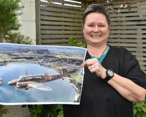 Marryllyn Donaldson displays a picture of an Avro Anson Mk1, the model of aircraft her...