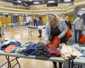 Sarah Millwater, of Hawea Flat, searches through clothing yesterday at Wanaka Swaps.