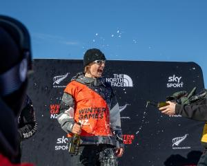 Carlos Garcia Knight celebrates on the podium after winning the men's snowboard event at the...