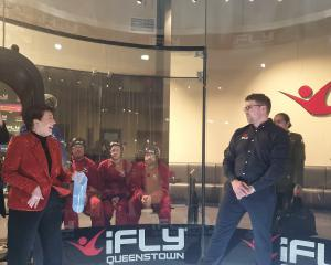 iFly sales and marketing manager Jason Williams (right) shows New Zealand Governor-General  Dame...