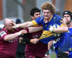 Taieri loose forward Nick Henderson charges forward against Alhambra-Union at the North Ground on...