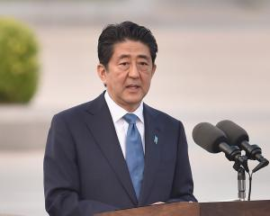 "Japanese Prime Minister Shinzo Abe described the launch as a ""grave threat"" to Japan and said its..."