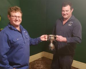 Millers Flat Rodeo Club secretary Mark Booth (left), of Ettrick, receives his trophy from club...