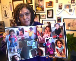 Tracey Elvins holds images of her daughter Hineihana, who died in 2013 after substandard hospital...