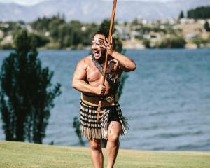 Tourists want to know more about Maori culture ...  Joe Waide, of WanaHaka, at work. PHOTO:...