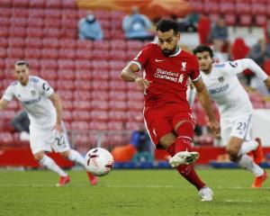 Liverpool's Mohamed Salah shoots to score their fourth goal to complete his hat-trick. Photo:...