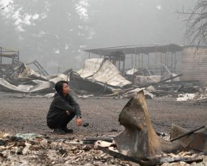 Hansel Valentine at the remains of the burnt down property of her relatives, as the wildfire...