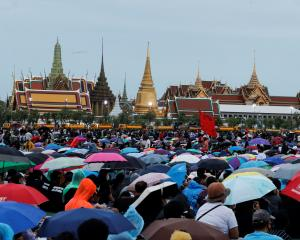 Thousands attend a pro-democracy rally in Bangkok, calling for curbs to the power of the monarchy...