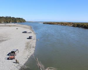 Whitebaiters on the Taramakau River on the West Coast. PHOTO: GREYMOUTH STAR