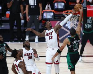 Bam Adebayo blocks Jayson Tatum on the final play of the Miami Heat's win over the Boston Celtics...