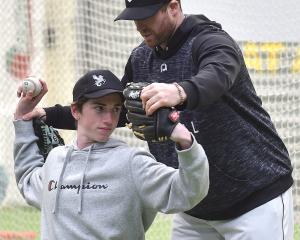 New Zealand Baseball coaching development manager Kris Richards giving some pointers to Kyal...