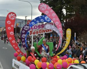 Senior Festival Queen Esther McKay (right) and runner-up Margaret Ruffell wave from their float...